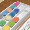 Les petits pots de sable coloré